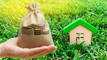 groen huis met zak geld subsidie